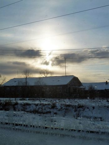 Train Window Architecture Beauty In Nature Building Exterior Built Structure Cloud - Sky Cold Temperature Day Nature No People Outdoors Scenics Sky Snow Tranquility Winter