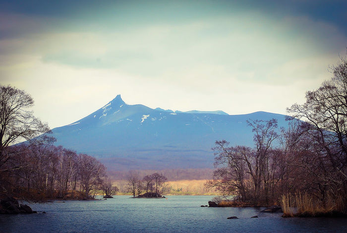 Mt. Komagatake and the mangroves at Lake Onuma during an early spring boat ride. | Location: Lake Onuma, Onuma-Quasi National Park, Nanae, Kameda District, HOKKAIDO-prefecture | Mt. Komagatake 駒ケ岳 大沼 大沼国定公園 北海道 Onuma National Park Mountain Landscape Mountain Range Cold Temperature Beauty In Nature Tranquility Travel Photography Mynikonlife Nikon D60 Nikonphotography Lakescape Lake Views National Park From My Point Of View EyeEmNewHere EyeEm Gallery EyeEm Best Shots - Landscape EyeEm Best Shots - Nature