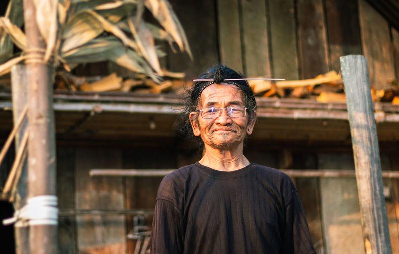 Portrait of smiling senior man standing outdoors