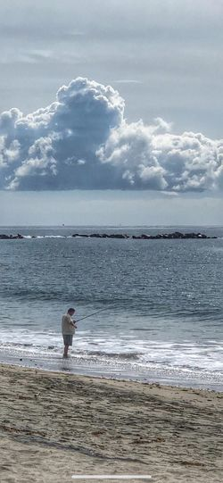 Anytime I see someone fishing, I think of my father. Fisherman Fishing HDR Hdr_Collection Sea Beach Water Land Sky Beauty In Nature Scenics - Nature Tranquility