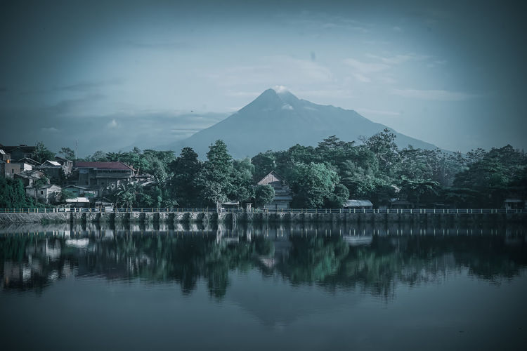 Scenic view of lake by trees against sky in tambak boyo yogyakarta indonesia