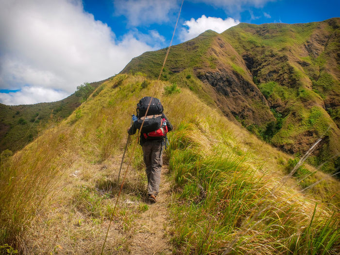 Mountain One Person Hiking Cloud - Sky Adventure Beauty In Nature Rear View Activity Sky Full Length Leisure Activity Nature Walking Real People Scenics - Nature Plant Non-urban Scene Day Backpack Outdoors Mountain Range Trail International Women's Day 2019