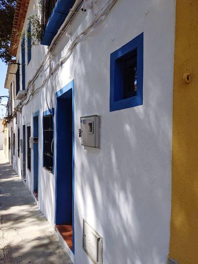 Buildings seen through closed door of building