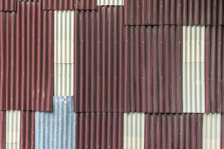 Architecture Backgrounds Building Exterior Built Structure Business Cargo Container Closed Corrugated Corrugated Iron Day Freight Transportation Full Frame Garage Industry Iron Metal No People Outdoors Pattern Sheet Metal Shutter Warehouse