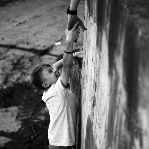 Climbing Child Childhood Rock Face Strength Climbing Wall Effort Rock Climbing Mountain Climbing Free Climbing Outdoor Play Equipment #urbanana: The Urban Playground Be Brave A New Beginning EyeEmNewHere Human Connection Moms & Dads