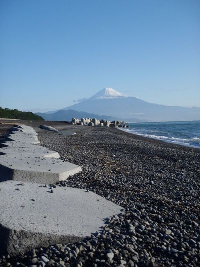 The beautiful view of Mt Fuji from the famous view point Miho no Matsubara. Japan Beauty In Nature Tranquility Idyllic Mtfuji Outdoors Mountain Mountains Tranquil Scene Heritage Icon National Monument Snow Rocky Beach Shizouka Nationalpark