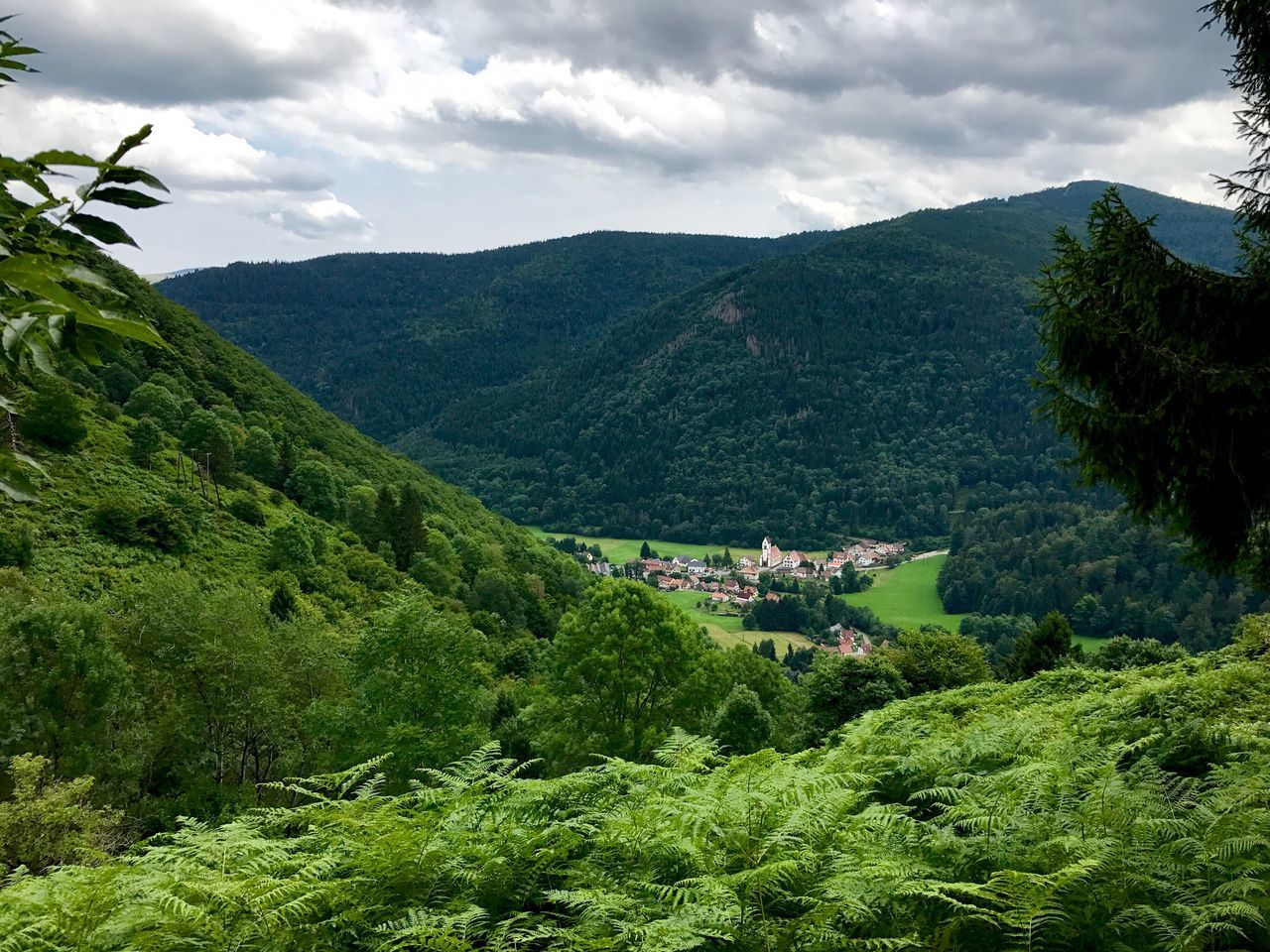 High Angle View Of Green Mountains Against Sky