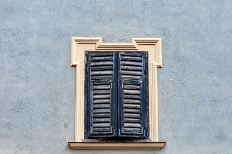 Close-up of closed window of building
