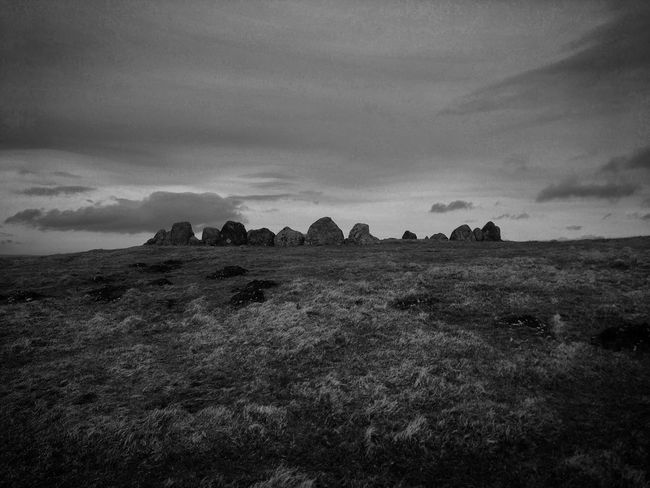 Moody Sky Black And White Stone Circle Sky Nature No People Cloud - Sky Landscape Field Day Outdoors Beauty In Nature Scenics Grass Architecture