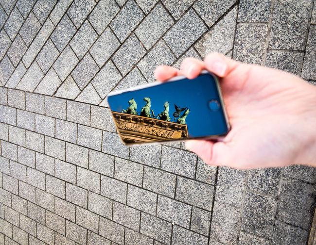 Reflection Of Brandenburg Gate In Smart Phone