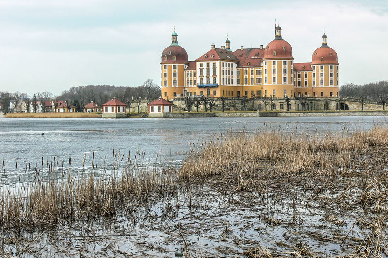 lake and castle Moritzburg in Saxony Castle Winter Architecture Building Exterior Built Structure Cloud - Sky Cold Temperature Day House Lake Nature No People Outdoors Sky Travel Destinations Water Winter
