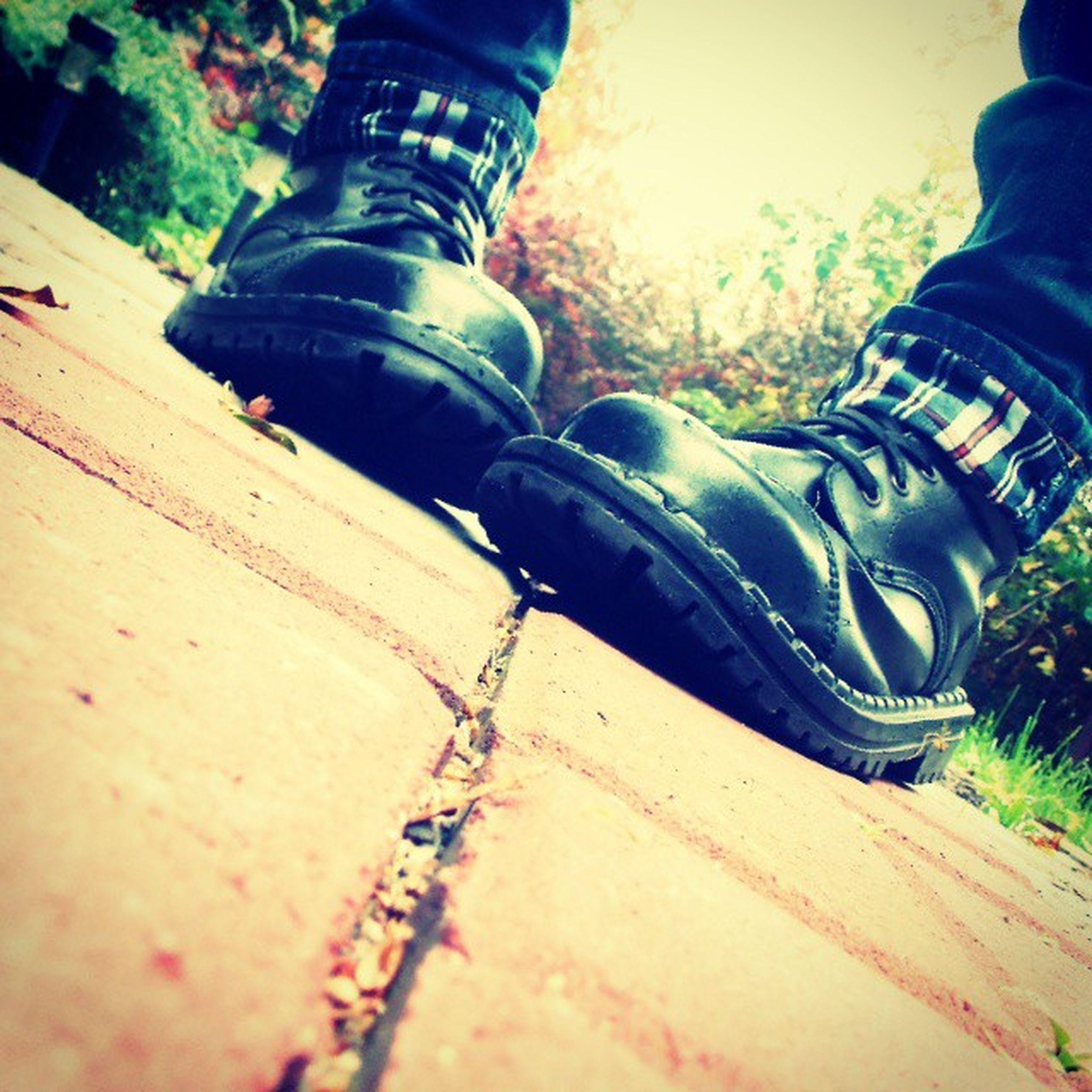 low section, person, shoe, men, lifestyles, leisure activity, human foot, footwear, jeans, standing, unrecognizable person, high angle view, personal perspective, part of, outdoors, day, street