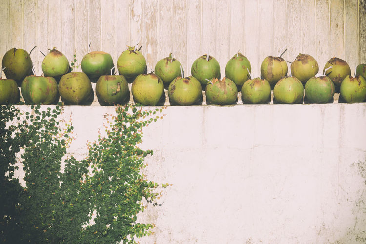 Green apples on wall