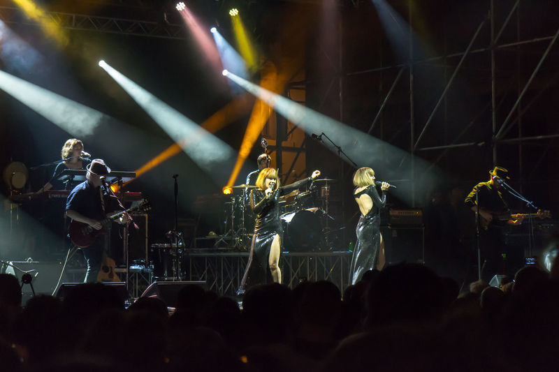 Rome, Italy - June 21, 2016: The Brigitte sing in Piazza Farnese, on the stage of a public concert organized by the French Embassy in Rome, at the European music festival. Brigitte  Concert Duet Europe Festivals French Group Illuminated Instruments Lights Live Music Music Musicians Night Rome Show Singers Stage