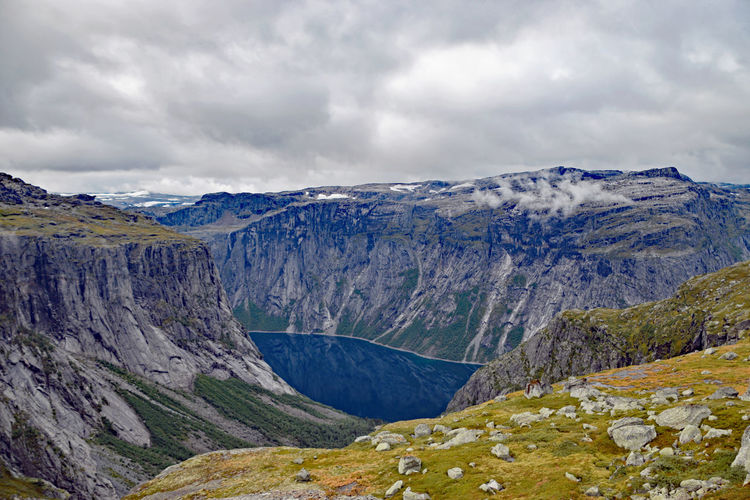 View along Trolltunga hike Norway Beauty In Nature Cloud - Sky Day Environment Formation Lake Landscape Mountain Mountain Peak Mountain Range Nature No People Non-urban Scene Outdoors Remote Rock Scenics - Nature Sky Tranquil Scene Tranquility Trolltunga Norway Hiking Water