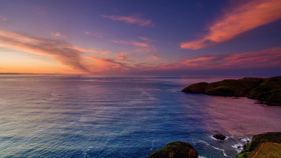 052 jacks bay sunset colorful panorama scene Wanderlust Aboutpassion Aerial Photography Beach Beauty In Nature Cloud - Sky Horizon Horizon Over Water Idyllic Land Nature No People Non-urban Scene Rock Scenics - Nature Sea Sky Solid Sunset Tranquil Scene Tranquility Vanlife Water