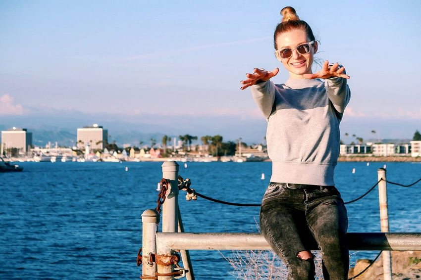 Smiling Stylish Woman Portrait Water One Person Lifestyles Real People Casual Clothing Glasses Fashion Young Adult Sky Day Sunglasses Leisure Activity Front View Sunlight Outdoors