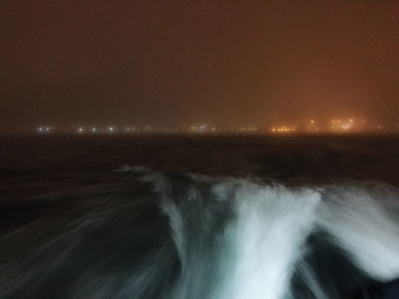 nature, sea, motion, beauty in nature, blurred motion, tranquility, scenics, water, long exposure, no people, tranquil scene, outdoors, night, sky, wave, illuminated