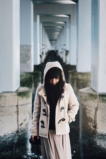 Winter again Winter Depth depth of field Japan EyeEm Best Shots Vscocam Urbanphotography Woman Portrait One Person Clothing Architecture Water Front View Built Structure Standing EyeEmNewHere