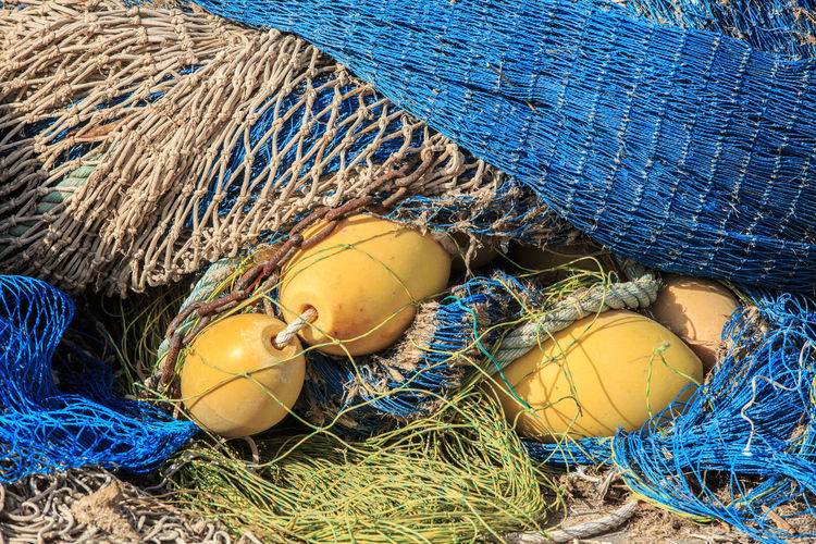 Blue Commercial Fishing Net Fishing Fishing Industry Fishing Net Fishing Rod Float Full Frame No People Outdoors Rope Still Life Yellow
