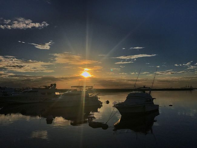 Photography Jaysalvarez Reflection Sunset Water Sun Sky Sunbeam Scenics Nautical Vessel Nature Tranquility Beauty In Nature Mode Of Transport Transportation Outdoors Tranquil Scene Sunlight Silhouette Cloud - Sky No People Lake