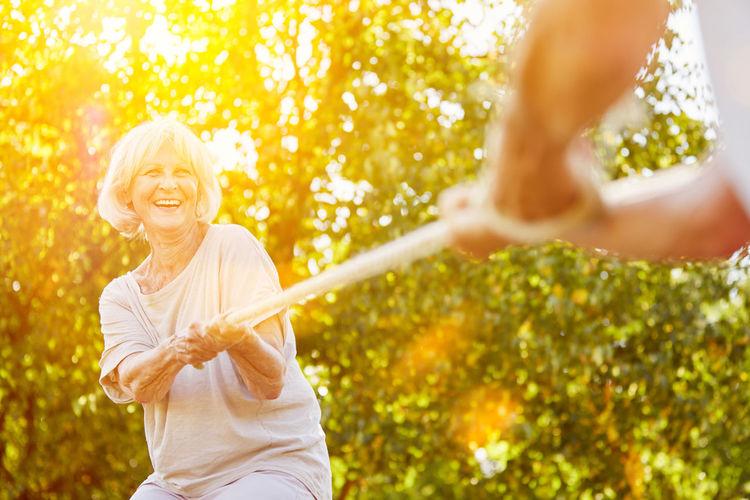 Senior Couple Playing With Walking Cane