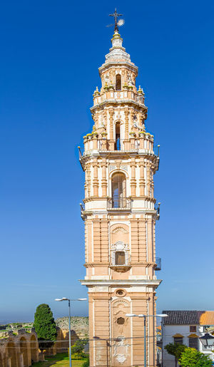 Baroque Tower of Victory in Estepa, province of Seville. Charming white village in Andalusia. Southern Spain. Picturesque travel destination on Spain. Estepa Sevilla Estepa SPAIN Seville Tourism White Villages Sun Sky Europe Cityscape Andalusia Andalusian Architecture City Town Village Andalucía Travel Travel Destinations Blue Architecture Tower Summer Outdoors European  Tourist Mediterranean  Traveler Beautiful Province Street Spanish Traditional Destination Vacations Landmark