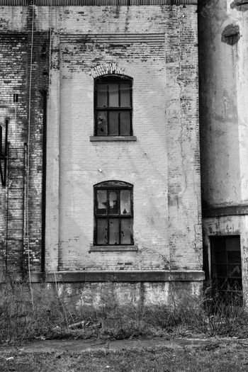 Abandoned grain silo mill Bradleywarren Photography Bradley Olson Backgrounds Background No People Room For Text Copy Space Copyspace The Way Forward Old Old-fashioned Old Ruin Old Buildings Abandoned Abandoned Places Abandoned Buildings Abandoned & Derelict Vintage Retro Architecture Built Structure Building Exterior Building Window Day Door Entrance Outdoors Run-down Damaged Obsolete House Weathered Residential District Deterioration Decline