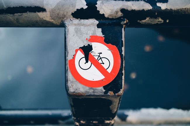 Don't park your bike just anywhere. They'll cut your locks. Close-up Focus On Foreground Symbol No People Outdoors Circle Red No Parking Bike Forbidden Amsterdam Water Regulations