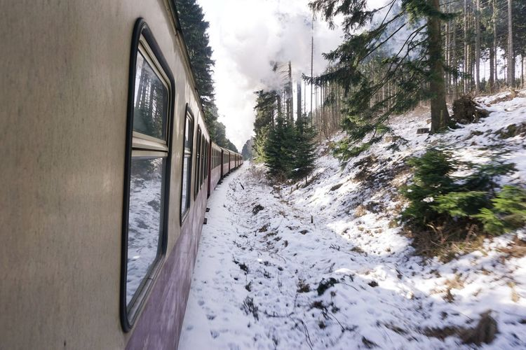 Close-up of train passing through snow covered landscape