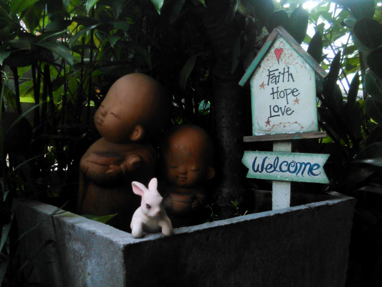 FAITH & HOPE & LOVE to all of you Animal Themes Children Children Statue Clay Sculpture Entrance Faith Faithhopelove Figurine  Flower Box Hope Jungle Feeling Love Love Sign Lovely Mammal Monks On The Doorstep Rabbit Rabbit 🐇 Sculptures Trees In Background Welcome Welcomeboard White Rabbit Wishes