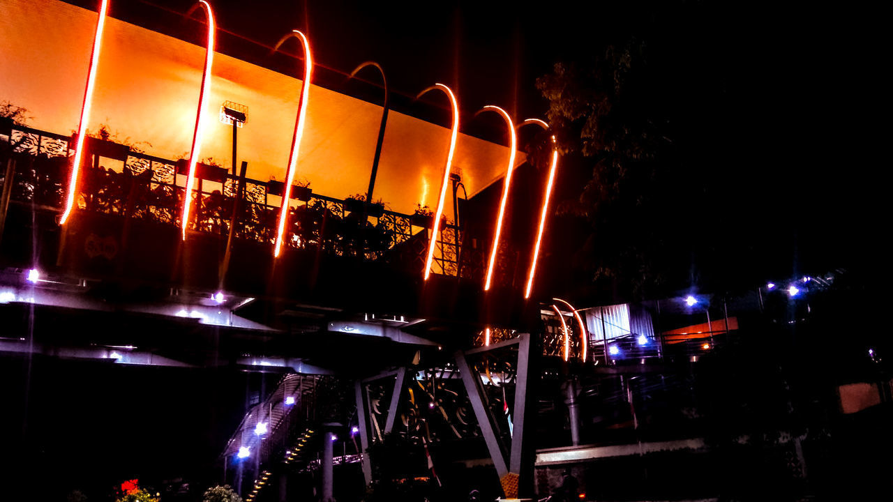 night, illuminated, no people, glowing, restaurant, built structure, architecture, nature, table, business, lighting equipment, outdoors, building exterior, transparent, bar - drink establishment, orange color, nightlife, sky, glass, bar counter