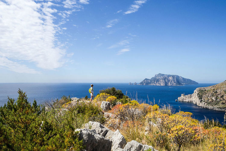 A nice and scenic view at the island of capri when hiking around the beautiful amalfi coast. Beauty In Nature Capri, Amalfi Coast, Trekking, Hiking, Travel, Traveling, Italy Day Horizon Over Water Nature Outdoors Rock - Object Scenics Sea Tranquil Scene Water