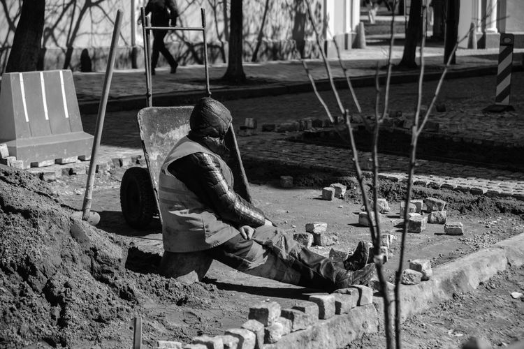 Architecture Day Full Length One Person Outdoors People Real People Sitting TCPM Thinking Worker The Photojournalist - 2017 EyeEm Awards