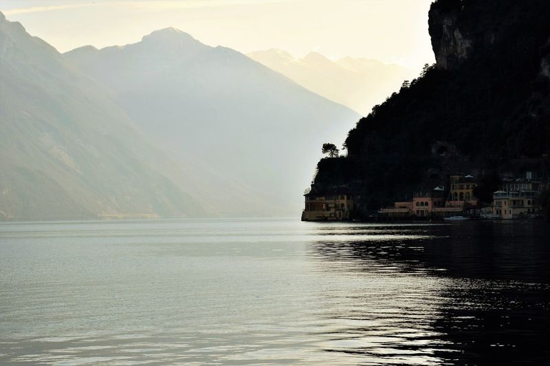 View of Garda lake Water Mountain Waterfront Beauty In Nature Nature Scenics - Nature Sky Tranquility No People Sea Tranquil Scene Mountain Range Architecture Outdoors Day Non-urban Scene Rock Garda Lake Italy Building Coast Fog Foggy Day Dusk Lake Landscape_Collection My Best Photo