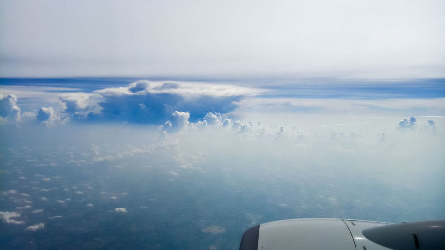 Airplane Over Land Aerial View Air Vehicle Airplane Beauty In Nature Cloud - Sky Cloudscape Day Engine Flying Jet Engine Mid-air Mode Of Transportation Motion Nature No People Outdoors Scenics - Nature Sky Transportation Travel