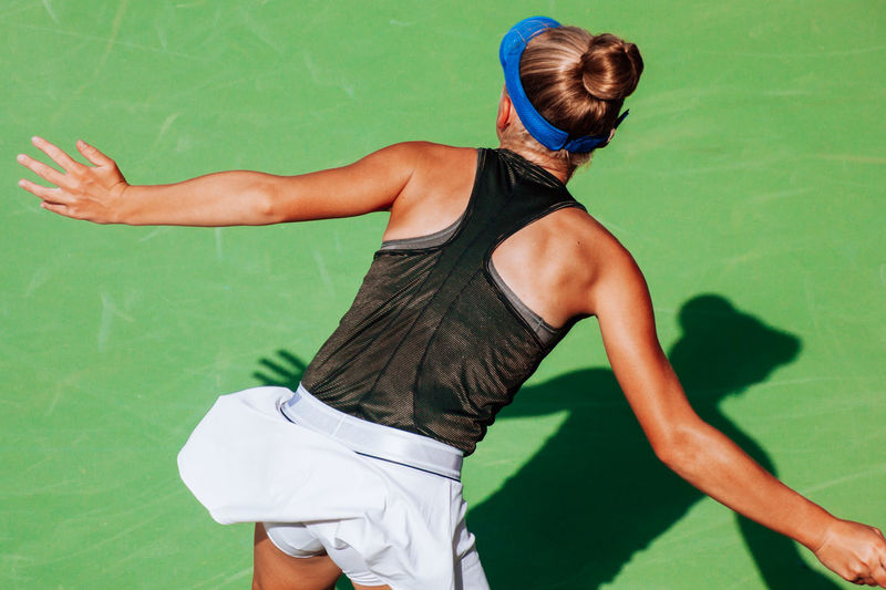 Girl playing tennis, young athlete, competitive sport, tennis court, shadow