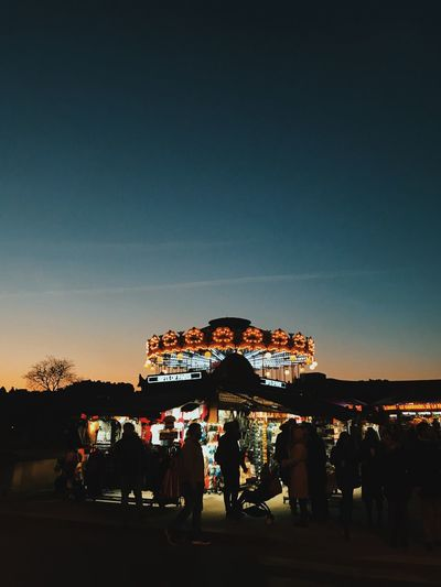 Mon enfance vient de passer devant mes yeux Childhood Carousel Arts Culture And Entertainment Amusement Park Leisure Activity Large Group Of People Night Enjoyment Silhouette Fun Illuminated Vacations Outdoors Lifestyles People Sky Carousel Nature Crowd Amusement Park Ride Real People