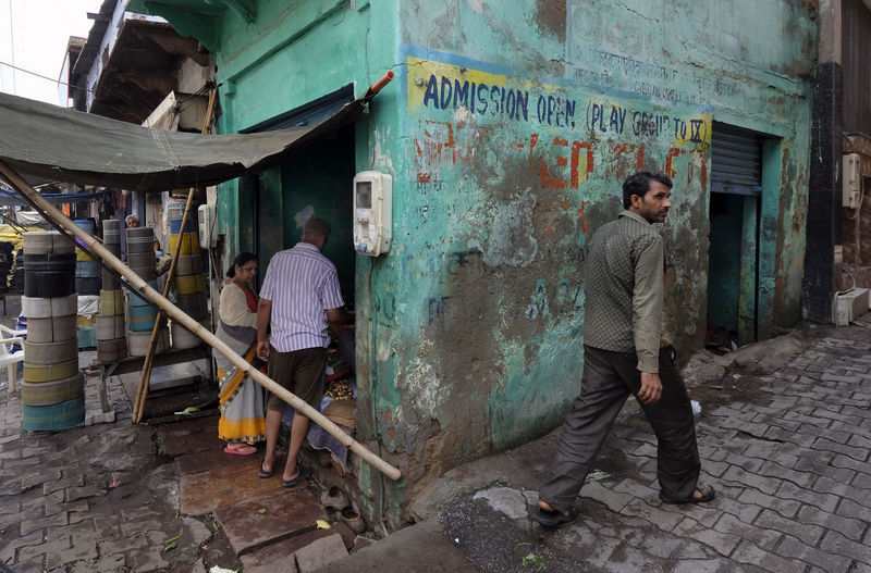 Rear view of people working on footpath