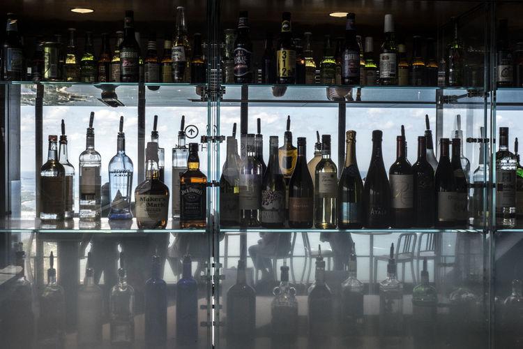 Liquor bottles in shelf