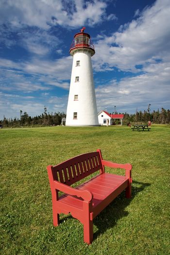 Canada, PE: Point Prim lighthouse Bench Cloud Confortable Daytime Grass Green Lantern Natural Light Perspective Red Signal Sit Architecture Blue Building Building Exterior Built Structure Canada Cloud - Sky Day Daylight Field Grass Guidance Land Lighthouse Nature No One No People Nobody Outdoors Plant Point Prim Prince Edward Island Protection Red Safety Security Sky Tower Vertical Warning White Wooden