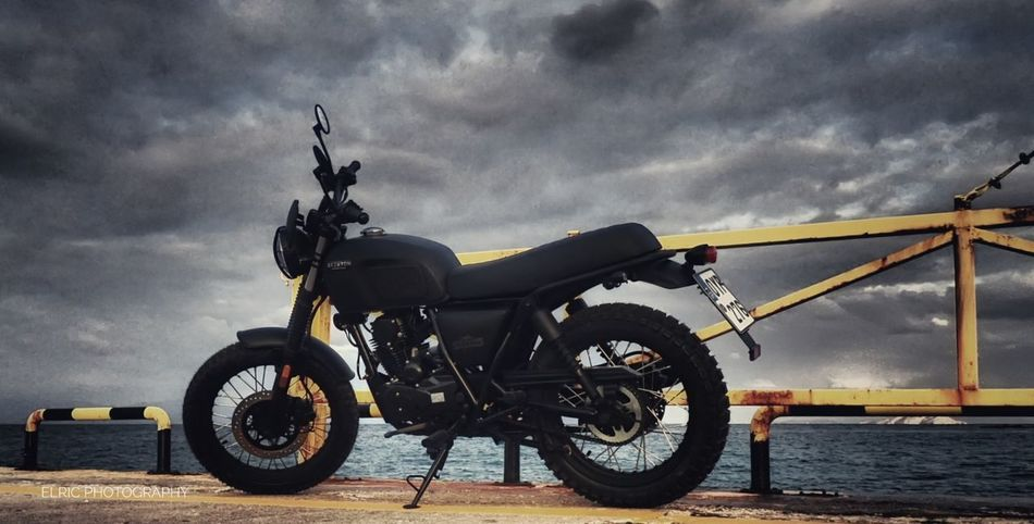 My new motorcycle for everyday use.I am in deep love. Motorcycle Cloud - Sky Sky Outdoors No People Day Headwear Strength Sea Olympus Photography Atmospheric Mood Olympus Olympus Tg5 Horizon Over Water Clouds Motorcycle Retro Retro Styled Clasic Brixton Black Totalblack