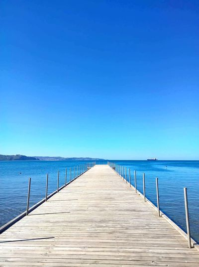 Blue Sea Sunny Clear Sky Water Boardwalk Outdoors No People Day Tranquility Sky Pier Skyporn Horizon Over Water Nature Non-urban Scene Beauty In Nature Scenics Landscape Nature Reserve Wheelchair Access