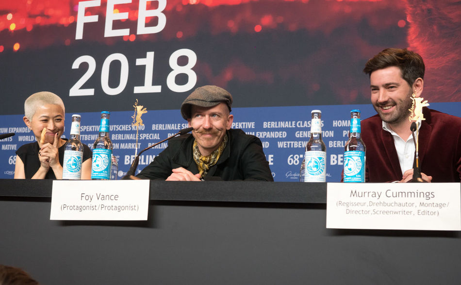 Berlin, Germany - February 23, 2018: Kimmie Kim, Foy Vance and Murray Cummings attend the 'Songwriter' press conference at 68th Berlinale 2018 Famous Film Film Festival Interview Premiere Press The Media Berlinale Berlinale 2018 Berlinale Festival Berlinale2018 Berlinale68 Conference Documentary Documentary Film Festival Film Industry Foy Vance Frontal View Hyunjoo Kim Kimmie Kim Mass Media Murray Cummings Press Conference Songwriter