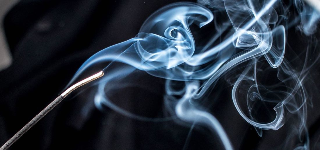 Close-up of smoke emitting from incense stick