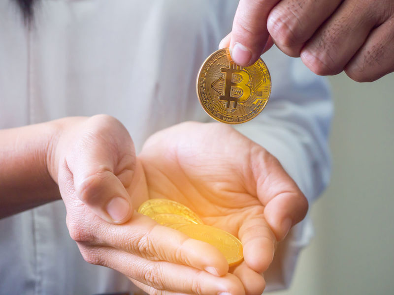 Hand of man putting golden bitcoin on women's palm against white background. Bitcoin Bitcoin Cash Bitcoin Coin Bitcoin Currency Bitcoin Miner Bitcoin Mining Blockchain Blockchain Concept Blockchain Technology Body Part Close-up Coin Crypto Cryptocurrency Cryptocurrency Mining Finance Finger Hand Holding Human Body Part Human Finger Human Hand Indoors  Real People Savings