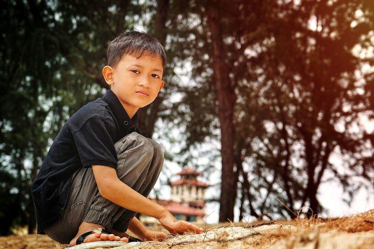 Portrait of boy in sunlight