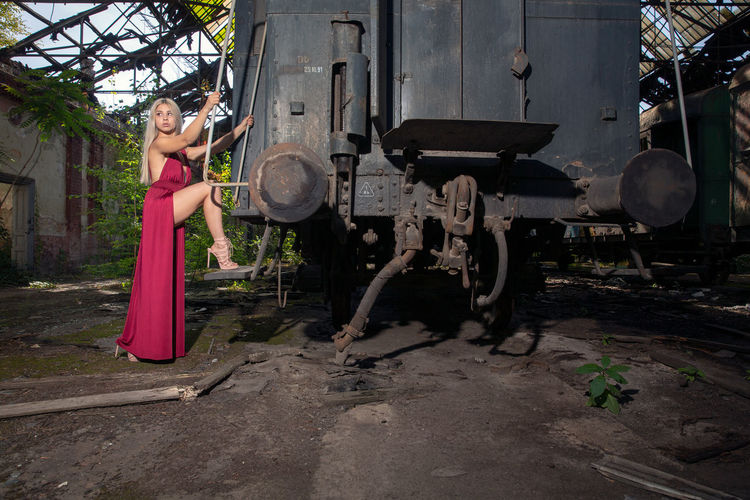 Young woman standing in abandoned shunting yard