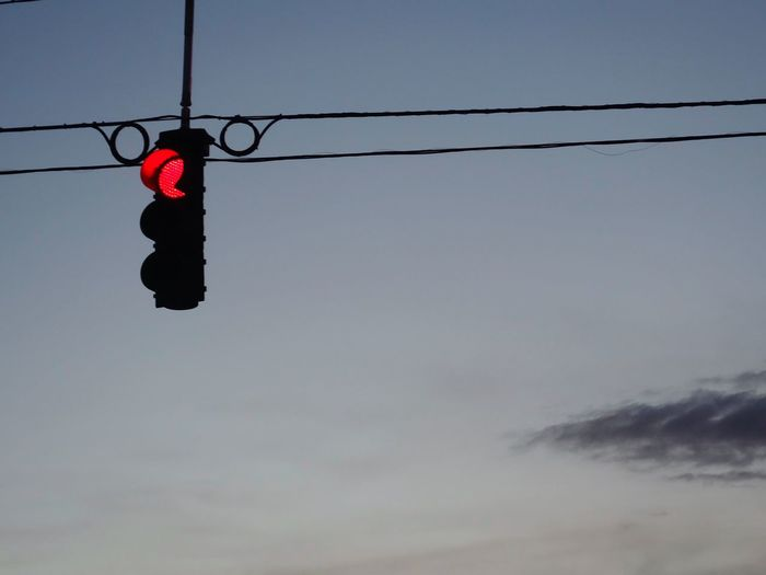 Low Angle View Of Stoplight Against Sky