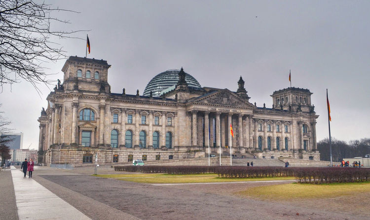 """The """"Reichstag"""" building: The home of Germany's parliament. Architecture Berlin Building Exterior Built Structure Bundestag Capital Cities  City Dome Façade Famous Place Germany Government Government Building Government Property History International Landmark Parliament Reichstag"""
